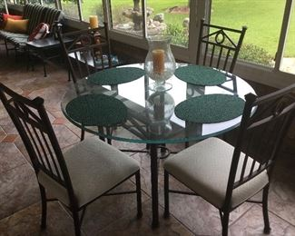 Exquisite outdoor glass table and chairs.