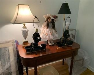 Game table and vintage horse lamps.