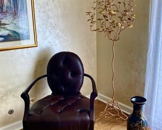 Leather Accent Chair with Arm Rests and Oval Back.