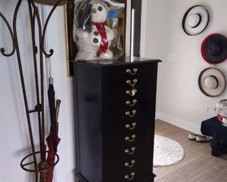 Metal hat and umbrella stand, antique snow man, pain music sheet cabinet.  Vintage sun hats, two are new and one worn once.   I used it to store my jewelry!
