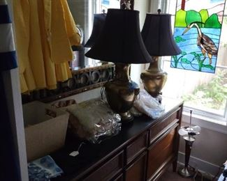 Stained glass, brass lamps, baby blankets