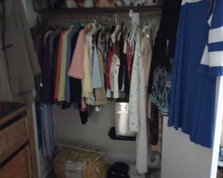 Women's clothing, new and gently used, stuffed animals, cabbage patch doll down blanket, shoe hanging caddies, high heeled black and white gym shoes, so cool!