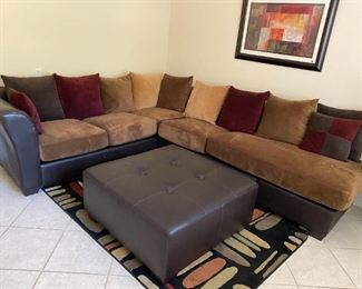 Large leather sectional with ottoman
