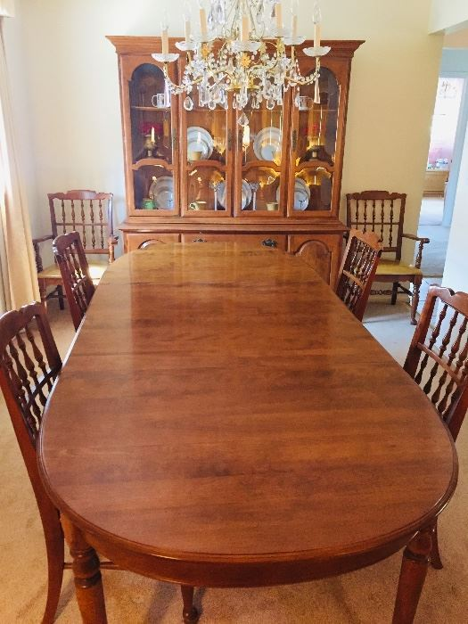 Ethan Allen perfect condition dining room set.  When fully open table measures 44x102 and fits 10-12 people.  2 leafs for table with protective table pads.  Display hutch on top with light and bottom storage cabinet. 6 chairs (4 chairs + 2 arm chairs). Top quality.  Moving sale.  $500.