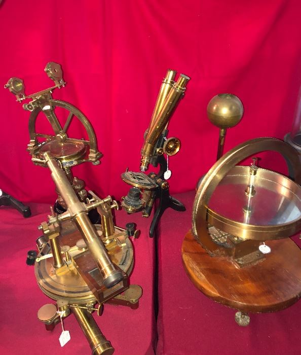 """Antique brass scientific measuring instruments of all sorts! In foreground left Lorieux Paris, telescope theodolite instrument. Background left instrument by E. T. Newton & Son. Binocular """"Challange"""" microscope by Swift & Son, London."""