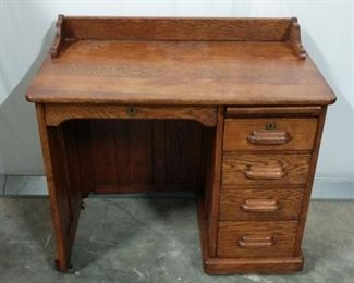 """Small antique oak desk. Measures 34""""x19""""x31"""". Please note that two of the rollers (front rollers) are broken. https://ctbids.com/#!/description/share/1012594"""