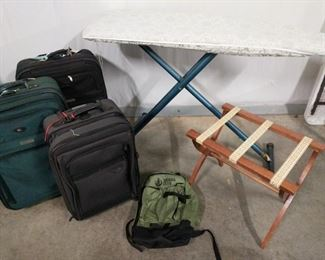 """Luggage rack, ironing board and luggage. Sierra Club, Atlantic, and more. Large suitcases measures 20""""x12""""x29""""."""