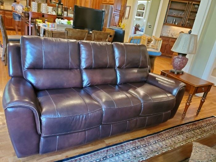 Leather reclining nearly new. Back lay down almost flat on seats