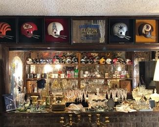 Amazing bar and man cave complete with mini NFL helmets and bat cast with Ebony Culver Baroque 22kt gold glasses