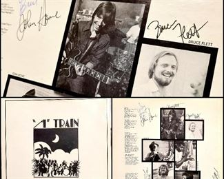 """If you don't remember """"A"""" Train, you've probably heard of them, or you've at least heard of Buddy Flett. This album isn't so easy to find on it's own, much less signed by all of the members. A true piece of recent Shreveport history."""