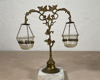GLORY LAMP | Whale oil lamp, having two blown glass reservoirs suspended from a vine-form support on marble base; overall h. 10-1/2 x w. 9-1/2 x d. 4 in.