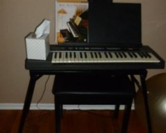 Casio keyboard on stand w/bench