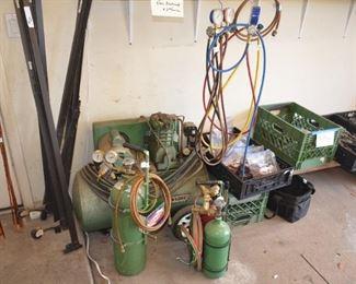 compresser, welding tanks, and assorted hand tools
