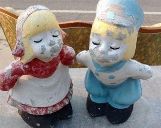 Concrete Kissing Dutch Statues
