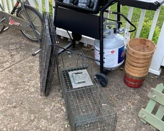Live trap, animal cage and BBQ grill.