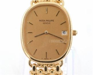 """18k Patek Philippe Wristwatch - Patek Philippe 18k """"Golden Ellipse"""" 4464/4 model gentleman's wristwatch.  1980's vintage with an E23C 7 jewel Quartz movement #1,580,252 with Champagne dial, date aperture and baton markers.  32 x 27 mm 18k Gold Ellipse case with an 18k Gold mesh Patek Philippe band. 75.9 grams total. Includes Certificate of Origin and sales material in a Red leather Patek Philippe folio, no box.  Minor case wear, scratches at opening slot, running when cataloged.  ESTIMATE $6,000-8,000"""