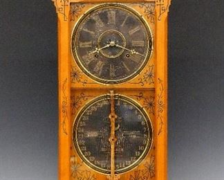 """Ithaca Belgrade Calendar Shelf Clock - A 19th century Ithaca """"Belgrade"""" model calendar shelf clock.  8-day time and strike movement with original Black dials, Roman numerals on time dial and Arabic on the calendar carved Ash pendulum.  Ash case with incised carvings highlighted in Black, shaped crest and single long door on a molded base.  Older refinishing with slight wear, some damage and substantial wear on time dial, minor wear on lower, running when cataloged.  32 1/2"""" high.  ESTIMATE $2,000-3,000"""