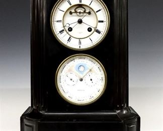 """French Slate Mantel Clock - A late 19th century French mantel clock.  8-day time only movement with a porcelain dial and Roman numerals.  Black Slate case with inset Marble decoration, incised designs with gilded detail.  Minor wear, hairlines in dial, running when cataloged.  9"""" high."""