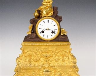 """Japy Freres French Bronze Mantle Clock With Dome  - An early 19th century Japy Freres Empire Bronze mantle clock.  8-day time and strike movement with convex porcelain dial and Roman numerals with engine turned bezel silk thread suspension.  Bronze case with two color Brown/Gilded patina, features an Allegorical figure of """"Autumn"""" holding shocks of Wheat with an amphora at her feet, seated on a rocky outcropping, on a base with finely cast Bronze facade with foliate scrolls, original fire gilded finish and shaped Brass sides.  Displayed within a blown glass dome on an oval   Ebonized molded wood base.  Well preserved finish with bright gilding and slight wear, running when cataloged.  The clock is 13 1/2"""" high, dome and base are 18 x 9 x 17 1/2"""" high overall."""