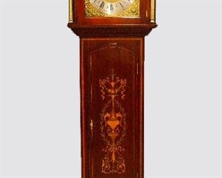 """British Inlaid Grandfather Clock - A good quality early 20th century British grandfather clock.  8-day weight driven movement with quarter hour Westminster chime on a nest of eight bells, with coiled hour gong,  a Brass dial with Silvered chapter ring and Roman numerals, upper Chime/Silent and seconds subsidiary dials flanked by cast spandrels.  Mahogany case with extensive inlaid urn and foliate detail features molded Swan neck pediment with turned Brass finial above an arched dial door flanked by fluted Brass columns over an arched inlaid waist door flanked by Satinwood banding, all on a paneled base with scrolled plinth.  Restored finish with only slight wear, movement recently overhauled, running and striking correctly when cataloged.  20 x 12 1/2 x 95 1/2"""" high overall."""