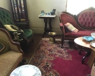 Curio cabinet, loveseat. Karastan rug with medallion in center, antique spitton, nice coffee table and marble top side table