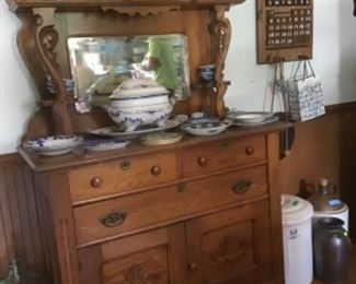 Oak sideboard with assortment of blue china