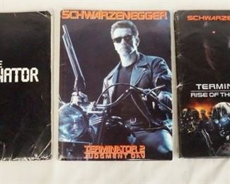 1009LOT OF THREE THE TERMINATOR MOVIE PRESS KITS. LOT INCLUDES THE TERMINATOR; CONTAINS 7 PRINTS INCLUDING ONE SIGNED & PRODUCTION INFO, THE TERMINATOR 2 JUDMENT DAY; CONTAINS 12 STILLS FROM THE FILM, A SCREENING INVITATION & PRODUCTION INFO, & THE TERMINATOR 3 RISE OF THE MACHINES; CONTAINS A SIGNED PRINT, PRODUCTION INO & A DIGITAL PRESS KIT.