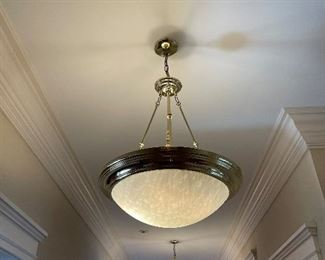 there are 5 of this style chandeliers in the long front hallway