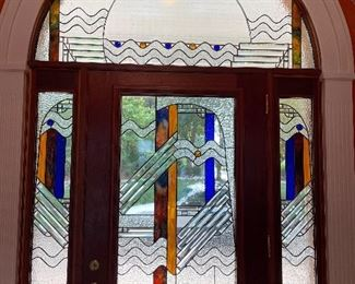 """stained glass windows in 4 sections: •(2) 45"""" by 8"""" side panels •center piece 45"""" by 27"""" • half circle over door 67"""" wide by 3' tall"""