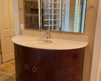 """there are a matching pair vanities 56"""" wide by 38"""" tall with well-lit mirrors"""