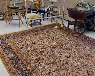 Iron bed, tea card, Persian rug, MT coffee table, oak rocker, foot stool, luggage rack, vintage art work.