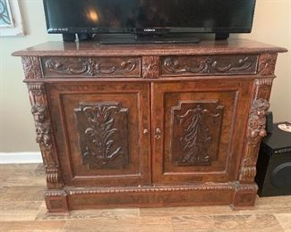 Beautifully carved Antique Buffet/stand with 2 drawers and doors.
