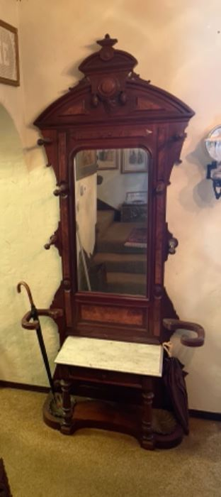 c1870 Mahogany stunning hall tree, umbrella stand, and hat and coat holder with white marble seat and large beveled mirror. Very tall.