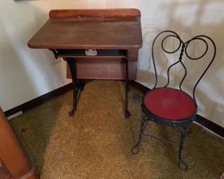 Child's antique school desk and bent wire ice cream chair