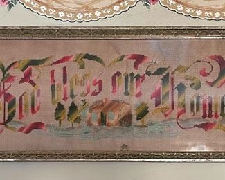 """Punched paper embroidery, can 1880, """"God Bless Our Home"""", green red and green with an embroidered home, trees and the sea"""