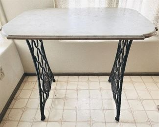 White marble bistro table with iron base