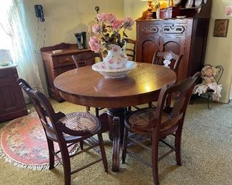 Victorian round pedestal dining table with four late 1800 period chairs