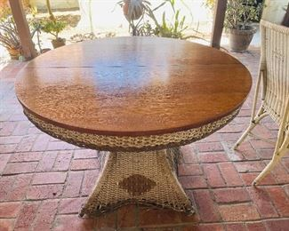 Tiger (quartersawn) oak topped wicker table and two chairs c1910, Craftsman style