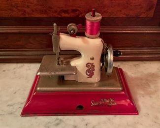 Strabo Sew O'Matic miniature child's sewing machine