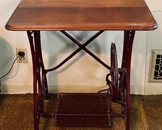 Sewing table with iron treadle base