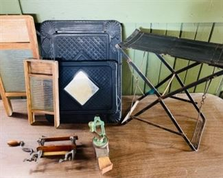 Miniature wash boards, a Victorian metal magazine rack with mirror, a folding ball game seat, miniature hand clothes wringer, and a small kitchen grinder