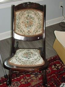 This has been described as a vintage 'sewing chair', with needlepoint backing.  $95.