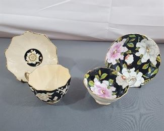 1 Tea cups and saucer pair Paragon black with flowers