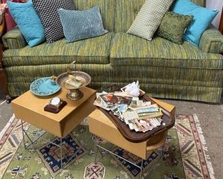 MCM couch, bentwood tables and beautiful rug. Old postcards and photos and MCM ashtrays