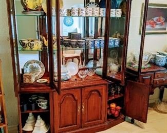 Cherry china cabinet with mirrored backing. All shelves feature a plate lip and the top drawer within the cabinet has a silverware organizer felt lined. In excellent condition.