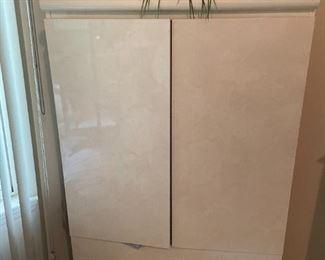 . . . the white-shellacked wardrobe