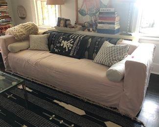 Very nice long sofa with pink slipcover