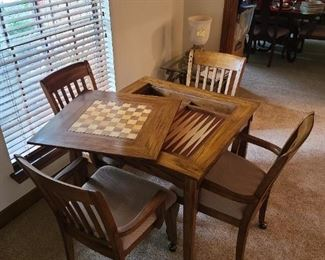 SURPRISE!!! Square  wood slat table with easy lift off top = game table ~ backgammon and checkers or chess Includes 4 chairs that roll