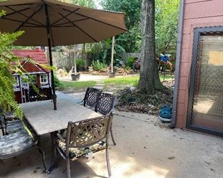 Stone top outside table w/umbrella w/6 chairs