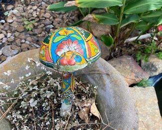Colorful mushroom yard art